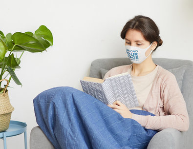 Face Mask Mockup of a Woman Reading in a Cozy Room m3723-r-el2