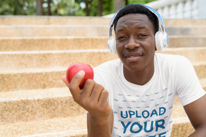 T-Shirt Mockup of a Man Eating an Apple While Listening to Music 40354-r-el2