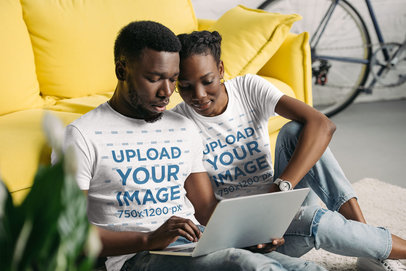 T-Shirt Mockup Featuring a Couple at Home Using a Laptop 45641-r-el2