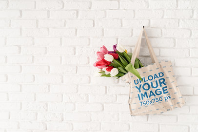 Tote Bag Mockup Featuring Some Tulips and a Brick Wall m4547-r-el2