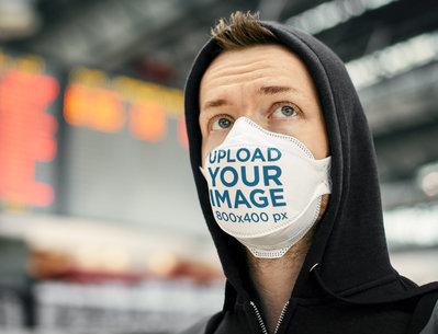 Mockup of a Man Wearing a Face Mask at an Airport Terminal 39887-r-el2