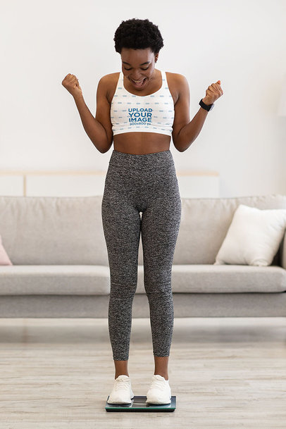 Sports Bra Mockup of a Happy Woman Standing on a Scale m6522-r-el2