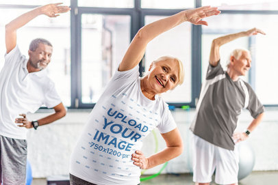 T-Shirt Mockup of an Elderly Lady at a Workout with Her Friends 46921-r-el2