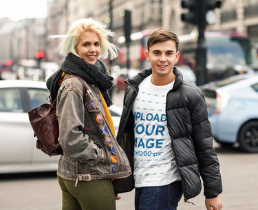 T-Shirt Mockup Featuring a Man with a Friend Wearing Winter Garments 42683-r-el2