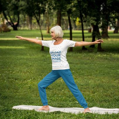 T-Shirt Mockup of an Elderly Woman Doing Yoga at a Park 46158-r-el2