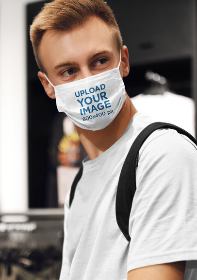 Face Mask Mockup Featuring a Young Man at a Clothing Store m4559-r-el2