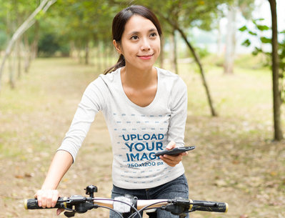 Long-Sleeve Tee Mockup Featuring a Woman With a Bike 46365-r-el2