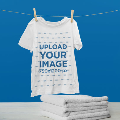 Mockup of a Hanging T-Shirt by Some Folded Towels 46150-r-el2