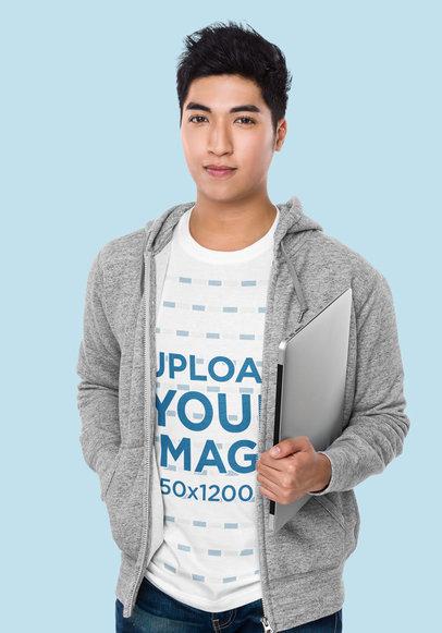T-Shirt Mockup of a Man Holding a Laptop at a Studio 46719-r-el2