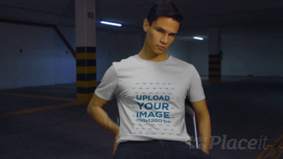 Basic T-Shirt Video Featuring a Man Posing in a Parking Lot 3110v