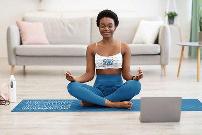 Sports Bra Mockup of a Short-Haired Yogi Meditating on a Yoga Mat m6489-r-el2