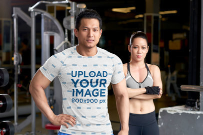 Sublimated Tee Mockup of a Muscular Man and His Partner at the Gym 45130-r-el2