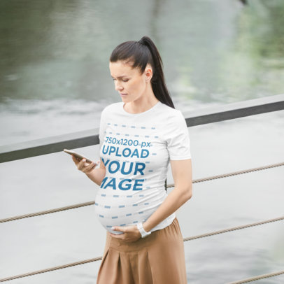 T-Shirt Mockup of a Pregnant Woman Walking While Using Her Smartphone m7679-r-el2