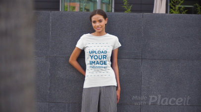 T-Shirt Video Featuring a Young Woman Posing in an Urban Scenario 3380v