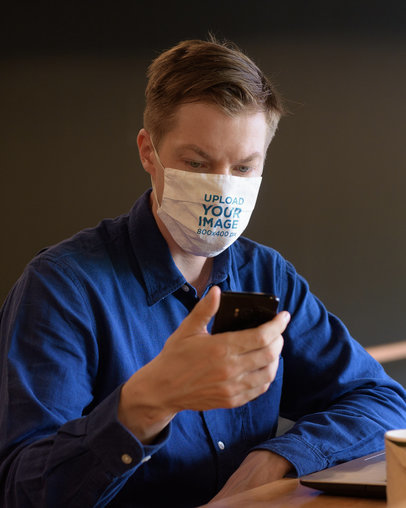 Face Mask Mockup Featuring a Man Checking His Mobile Phone 44026-r-el2