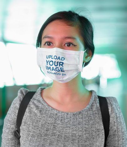 Face Mask Mockup of a Young Woman on the Street at Night 42832-r-el2