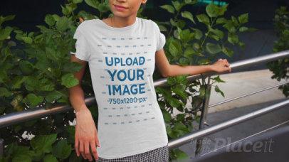 T-Shirt Video Featuring a Happy Woman Posing by an Urban Railing 3382v
