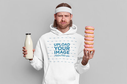 Hoodie Mockup of a Disappointed Man Holding Some Donuts m3729-r-el2