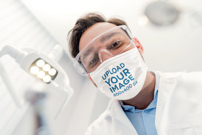 Face Mask Mockup Featuring a Dentist Working 44527-r-el2