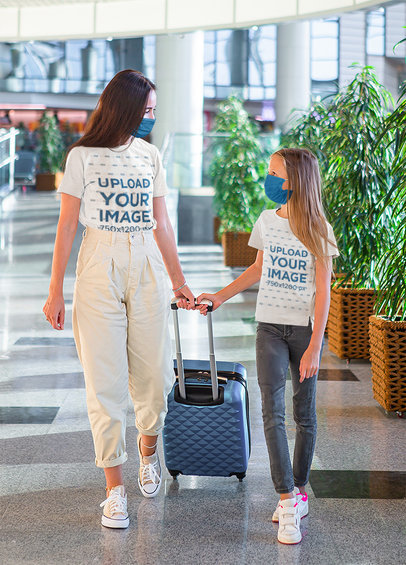 T-Shirt Mockup Featuring a Mother and Her Daughter at the Airport 45192r-el2