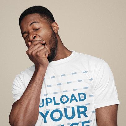 T-Shirt Mockup Featuring a Man Snoozing at a Studio 42598-r-el2