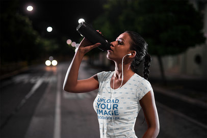 T-Shirt Mockup of an Athlete Drinking Water After Her Nocturnal Run 41435-r-el2