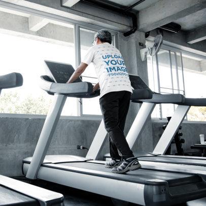 Back-View T-Shirt Mockup of a Senior Man Using a Treadmill M9818-r-el2