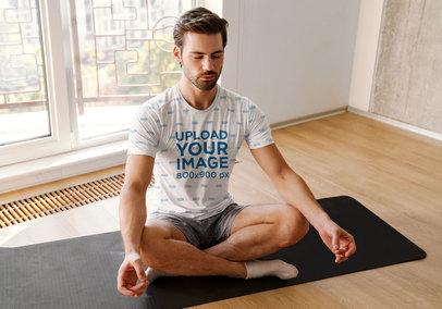 Sublimated T-Shirt Mockup of a Man Meditating at Home M6805-r-el2