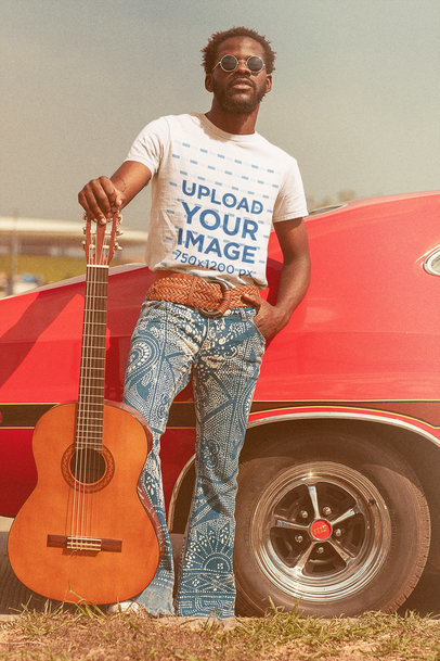 T-Shirt Mockup of a Man with His Guitar Posing by a Classic Car m10483