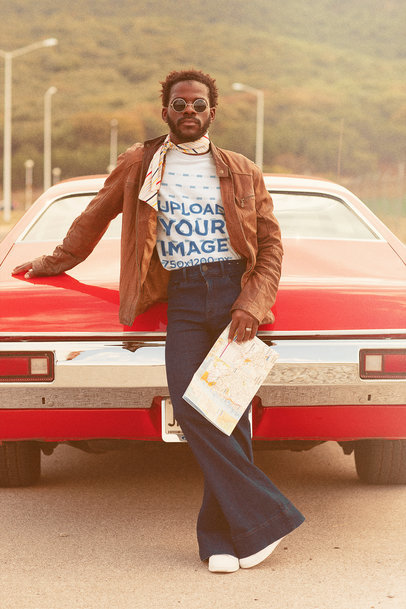 T-Shirt Mockup of a Man Holding a Road Map by a Classical Car m10490