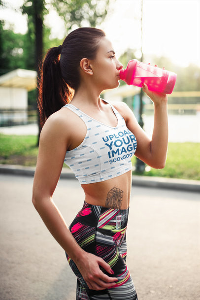 Sports Bra Mockup Featuring a Tattooed Woman During a Workout 38495-r-el2