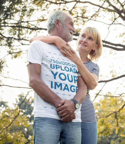T-Shirt Mockup Featuring a Senior Bearded Man and His Wife at a Park m9887-r-el2
