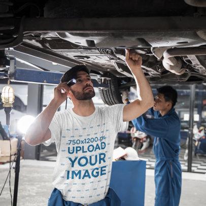 T-Shirt Mockup Featuring a Man Fixing a Car M9890-r-el2