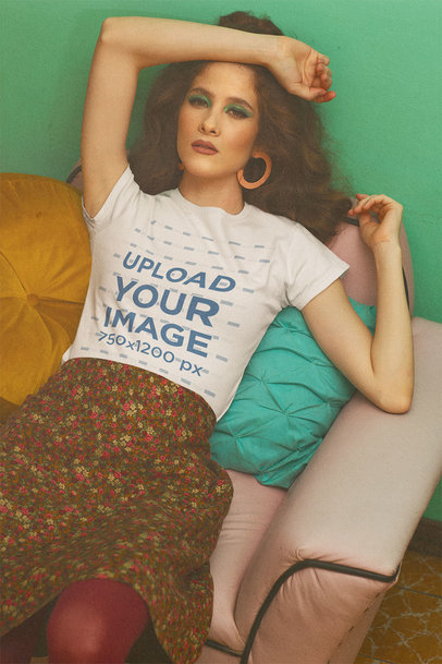 T-Shirt Mockup of a Woman Lying in a 70s Style Living Room m10527