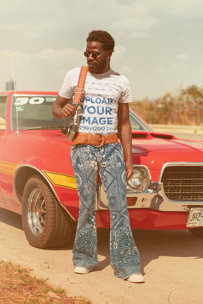 T-Shirt Mockup of a Man in a Retro Outfit Posing by a Muscle Car m10481