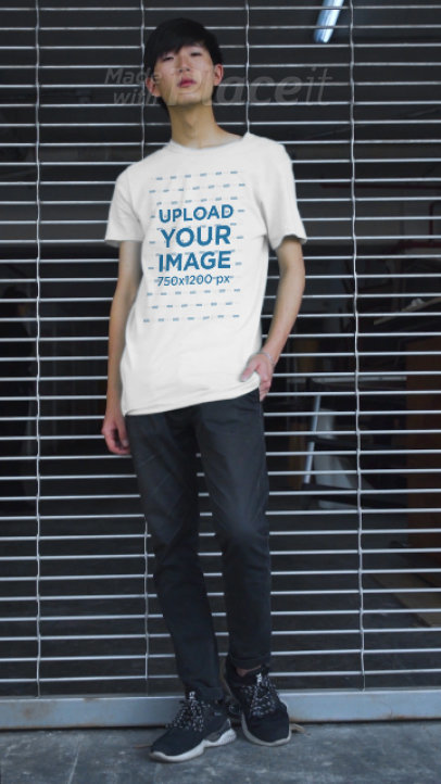 T-Shirt Video Featuring a Man Posing Against a Fence 3414v