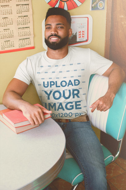 Round-Neck Tee Mockup of a Smiling Man at a Retro Setting M10522