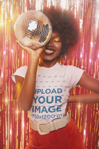 T-Shirt Mockup Featuring a Happy Curly-Haired Woman Holding a Disco Ball m10139