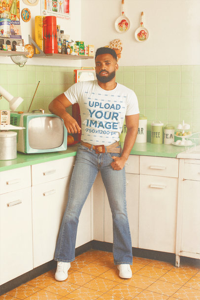 T-Shirt Mockup of a Man Inside a 70's Kitchen M10520