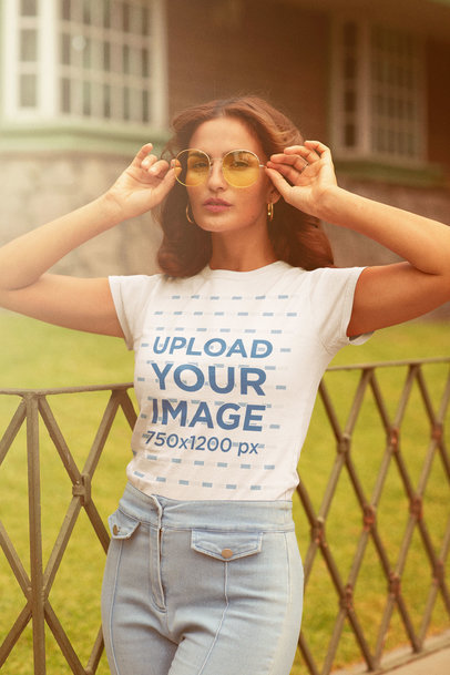 Round-Neck Tee Mockup of a Woman with Retro Sunglasses m10130