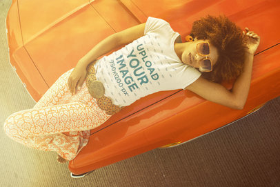 T-Shirt Mockup Featuring a Woman Lying on a Vintage Car Hood m10514