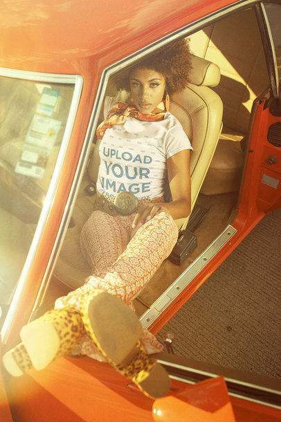Retro T-Shirt Mockup of a Woman Sitting in the Driver's Seat of a Classic Car m10510