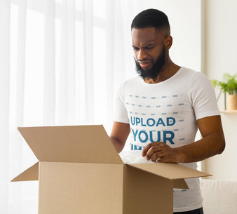 T-Shirt Mockup of an Angry Man Opening a Package 46247-r-el2