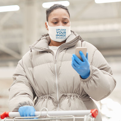 Face Mask Mockup of a Woman in Winter Wear Checking Her Phone 46658-r-el2