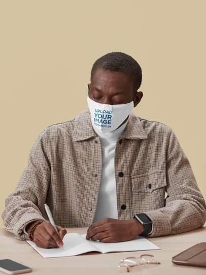 Mockup of a Man Wearing a Face Mask While Working in His Office 45537-r-el2