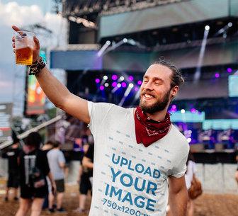 T-Shirt Mockup of a Happy Man Enjoying a Drink at a Music Festival M10175-r-el2