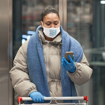 Face Mask Mockup of a Woman with a Shopping Cart Checking Her Phone 46665-r-el2