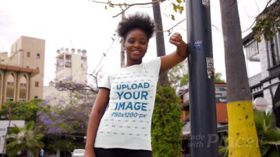 T-Shirt Video of a Happy Woman Posing by an Urban Lamp Post 3407v