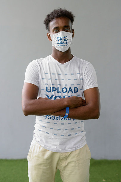 Mockup of a Man Wearing a Face Mask and a Tee While Crossing Arms m10110-r-el2