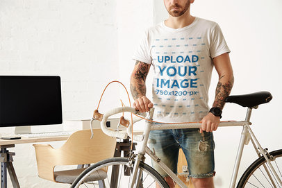 T-Shirt Mockup of a Man with Arm Tattoos Standing by His Bike M6286-r-el2